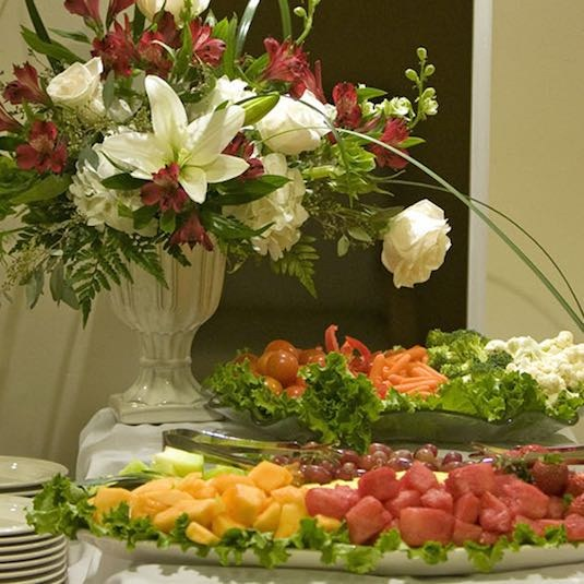 Catering display of food and flowers