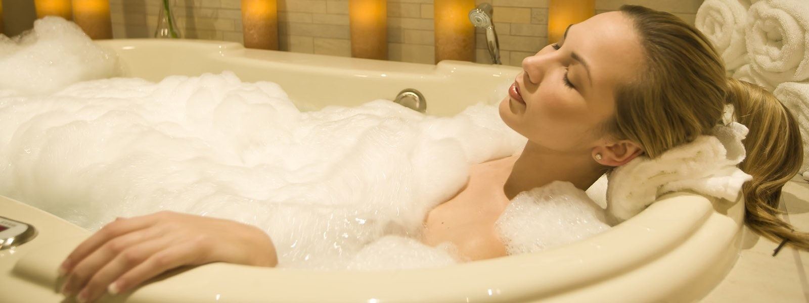 Woman relaxing in tub with bubbles