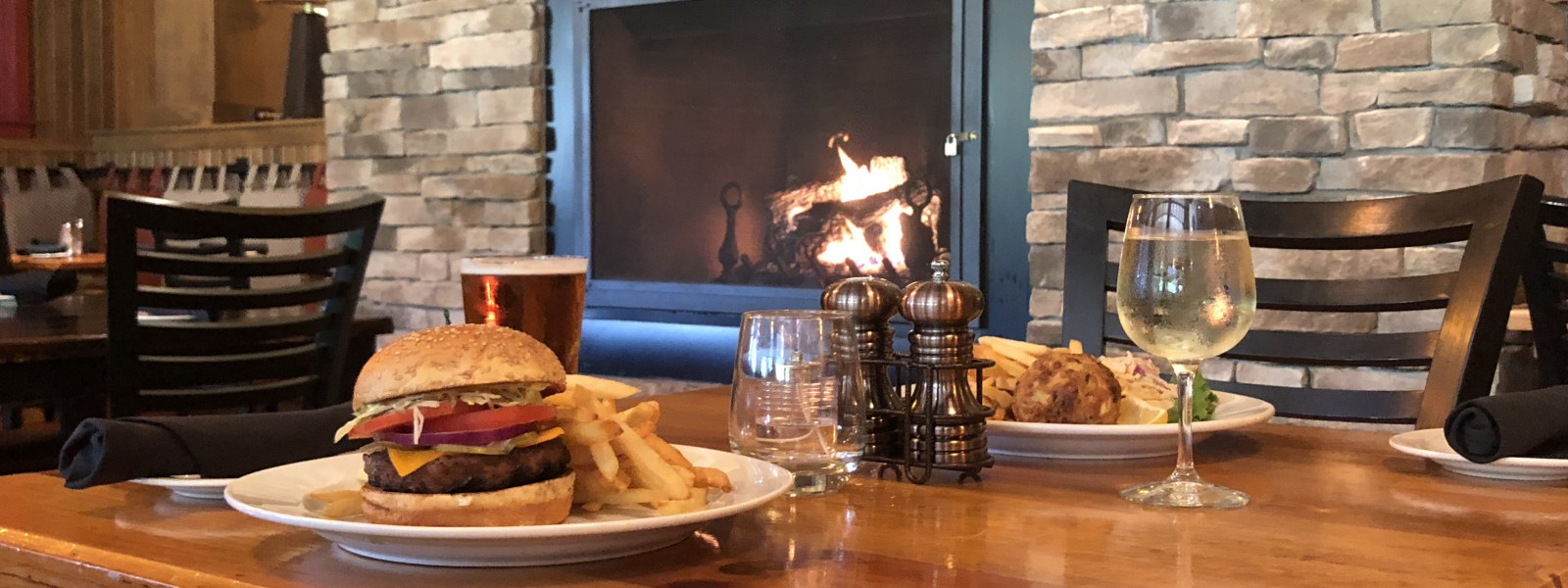 burger by fireplace in grille