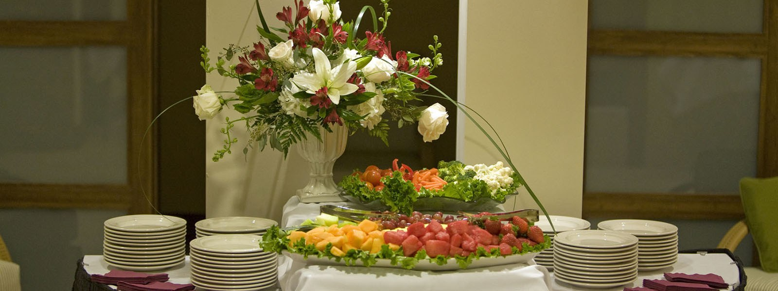 table of plates and flowers for wedding event venue