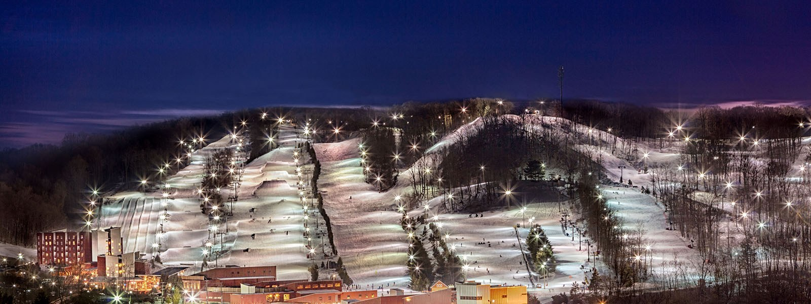 ski area lit up at night