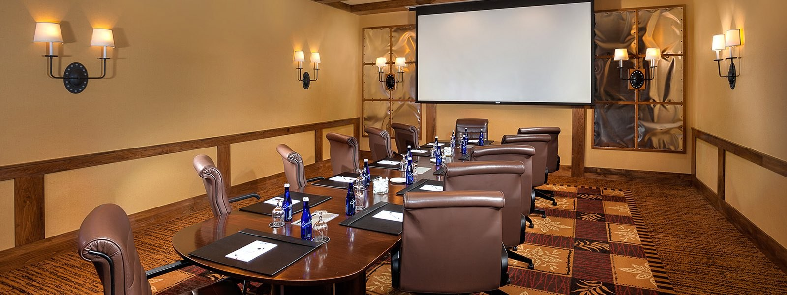 Corporate business conference venue with table and large screen