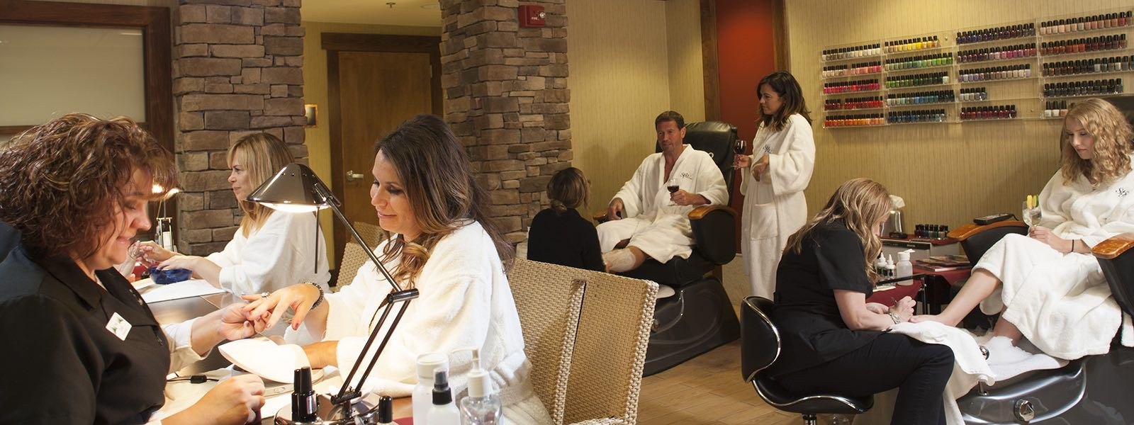 Salon full of people receiving treatments