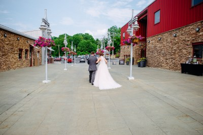 Bride and Groom Walking towards parking lot