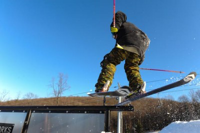 skier riding on rail