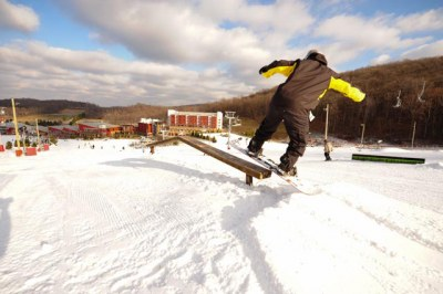 snowboarder approaching rail
