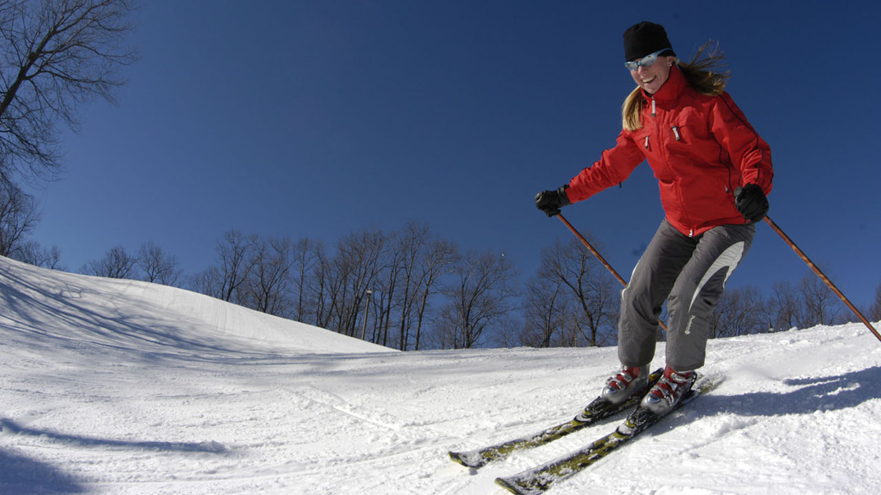 woman skier enjoying outdoor exercise in the winter