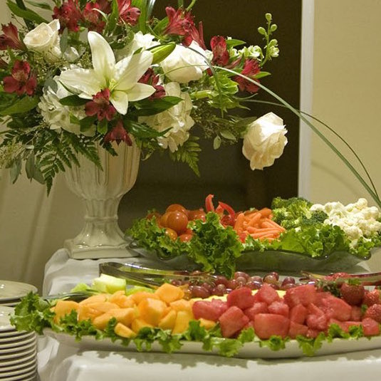 flowers and food setup for corporate business conference venue